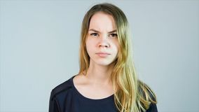 Young beautiful woman is angry on a white background. Angry young woman Stock Images