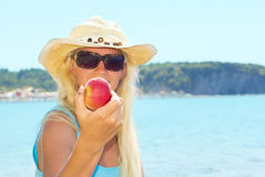 Young beautiful  woman with apple Royalty Free Stock Photos