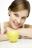 Young beautiful woman with apple stock photography