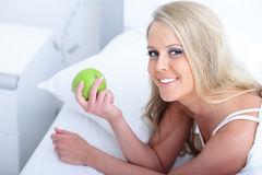 Young beautiful woman with apple Stock Images