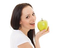 Young beautiful woman with an apple. Royalty Free Stock Photos