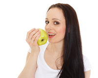 Young beautiful woman with an apple. Stock Images