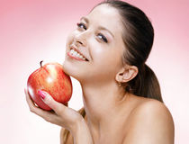 Young beautiful woman with apple Stock Image