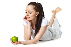 Young beautiful woman with an apple royalty free stock images