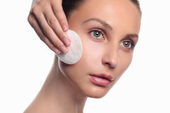 Young beautiful woman apply cosmetic sponge Royalty Free Stock Photos