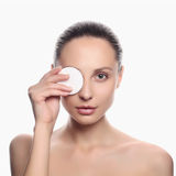 Young beautiful woman apply cosmetic sponge Royalty Free Stock Photo