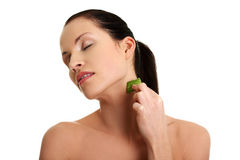 Young beautiful woman is applying aloe vera. Royalty Free Stock Photography