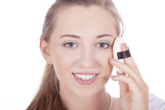 Young beautiful woman applying colored lipstick Royalty Free Stock Image