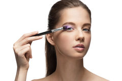 Young beautiful woman applying makeup Royalty Free Stock Photography