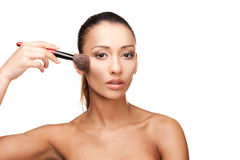 Young beautiful woman applying makeup Royalty Free Stock Images