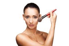 Young beautiful woman applying makeup Stock Photography