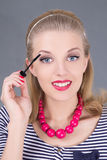 Young beautiful woman applying mascara make up on eyes Royalty Free Stock Photos