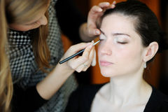 Young beautiful woman applying wedding make-up Royalty Free Stock Photos
