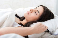 Young beautiful woman asleep in bed Royalty Free Stock Images