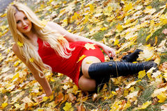 Young beautiful woman in an autumn park Stock Photo