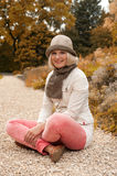 Young beautiful woman in autumn park royalty free stock photo