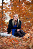 Young beautiful woman in autumn park Stock Photos