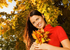 Young beautiful woman in the autumn park Stock Photography