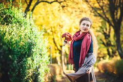 Young beautiful woman at the autumn park. Royalty Free Stock Photo