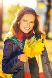 Portrait of young beautiful woman in autumn park. Young beautiful woman in autumn park Stock Images