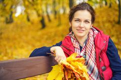 Portrait of young beautiful woman in autumn park. Young beautiful woman in autumn park Royalty Free Stock Photos