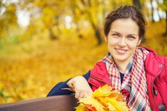 Portrait of young beautiful woman in autumn park. Young beautiful woman in autumn park Royalty Free Stock Photo