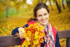 Portrait of young beautiful woman in autumn park. Young beautiful woman in autumn park Stock Image