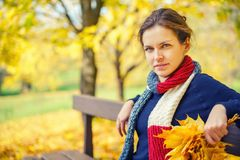 Portrait of young beautiful woman in autumn park Stock Images
