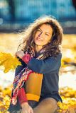 Portrait of young beautiful woman. Young beautiful woman in autumn park Royalty Free Stock Images
