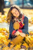 Portrait of young beautiful woman. Young beautiful woman in autumn park Royalty Free Stock Photos