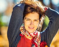 Portrait of young beautiful woman. Young beautiful woman in autumn park Royalty Free Stock Photo