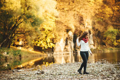 Young beautiful woman at the autumn park. Royalty Free Stock Image