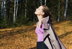 The young beautiful woman in autumn wood Stock Photography