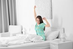 Young beautiful woman awaking. In light hotel room stock images