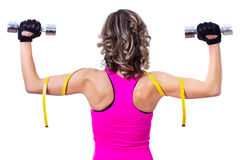 Young beautiful woman back doing fitness exercise Royalty Free Stock Photography
