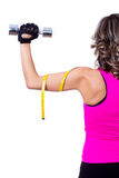 Young beautiful woman back doing fitness exercise Stock Photography