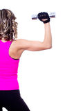 Young beautiful woman back doing fitness exercise Stock Photo