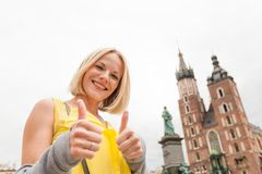 Young beautiful woman on the background of the St. Mary`s Church in Krakow royalty free stock photography