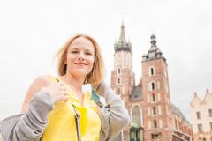 Young beautiful woman on the background of the St. Mary`s Church in Krakow stock images