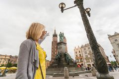 Young beautiful woman on the background of the St. Mary`s Church in Krakow stock photography