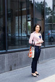 Young beautiful woman with bag in hand Royalty Free Stock Photography