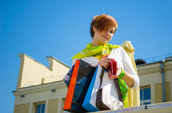 Young beautiful woman with bags after shopping Royalty Free Stock Image