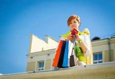 Young beautiful woman with bags after shopping Stock Photography