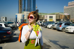 Young beautiful woman with bags after shopping in the parking Royalty Free Stock Photo