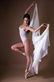 Young beautiful woman ballet dancer over beige Royalty Free Stock Image