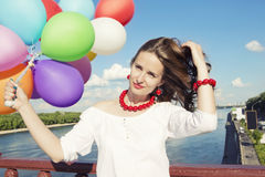 Young beautiful woman with balloons Stock Photo