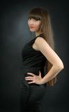 Young beautiful woman with bangs in studio Royalty Free Stock Images