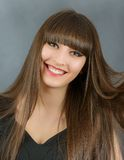 Young beautiful woman with bangs in studio Stock Photos