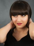 Young beautiful woman with bangs in studio Stock Images