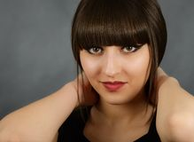 Young beautiful woman with bangs in studio Stock Photography